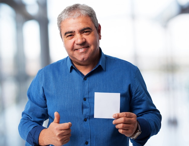 Portrait of a mature man holding a paper