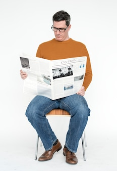 Portrait of a mature man reading the newspaper