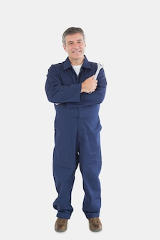 Portrait of mature mechanic with wrench
