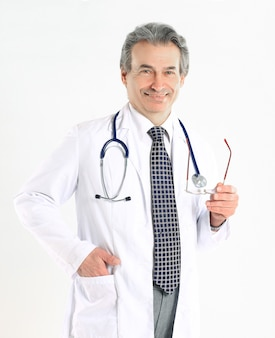 Portrait of mature medical doctor with white coat and stethoscope on isolated background