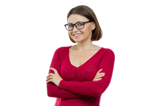 Portrait of mature smiling woman with glasses with arms crossed