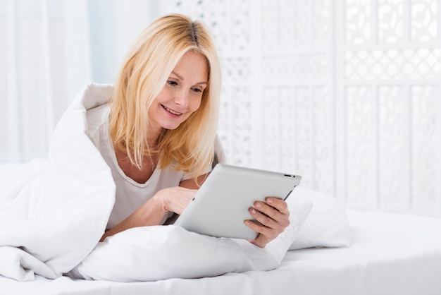 Portrait of mature woman browsing a tablet
