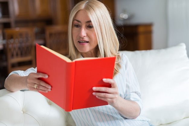 Portrait of a mature woman reading a book