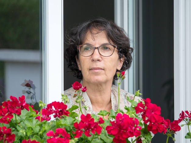 Portrait mature woman with flowers