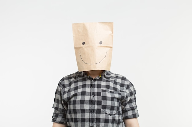 Portrait of men in happy paper bag mask on white background