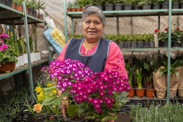 Portrait of a mexican woman  in nursery xochimilco, mexico