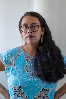 Portrait of a mexican young woman wearing tehuana clothes, diversity and empowerment concept