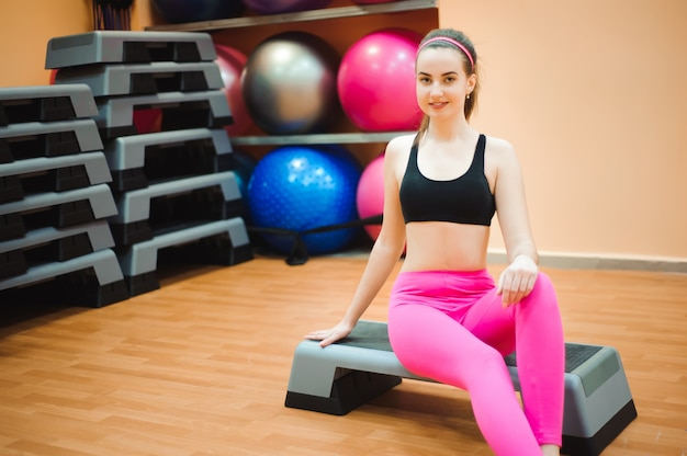 Portrait of middle age beautiful woman relaxing after fitness