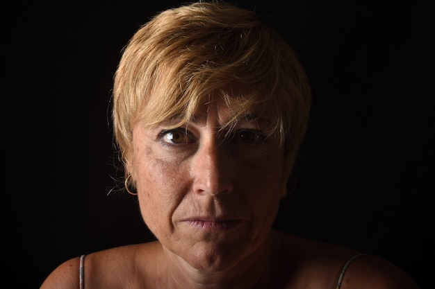 Portrait of a middle aged woman on blac