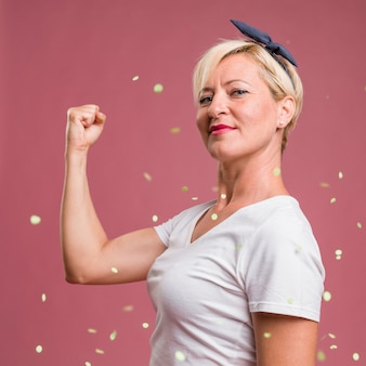 Portrait of middle aged woman in celebration pose