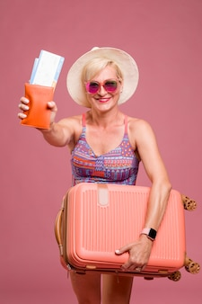 Portrait of middle aged woman going on summer vacation