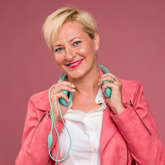 Portrait of middle aged woman with headphones