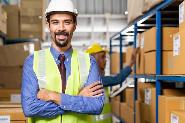 Portrait of middle east turkish white caucasian warehouse manager crossed arm