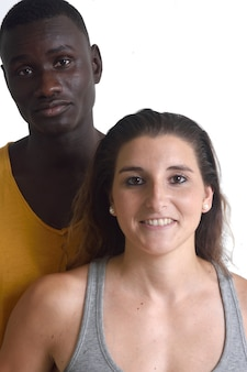 Portrait of a mixed couple on white,