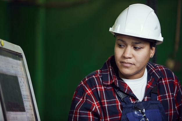 Portrait of mixed-race female worker at plant