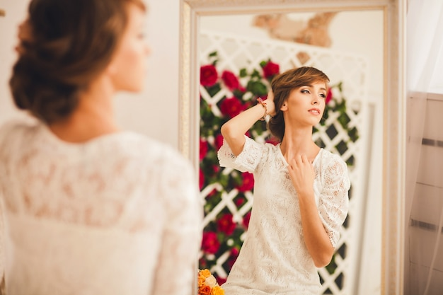 Portrait of a model posing in the mirror