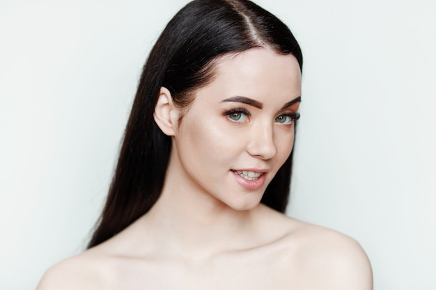 Portrait of model with nude make up and bare shoulder