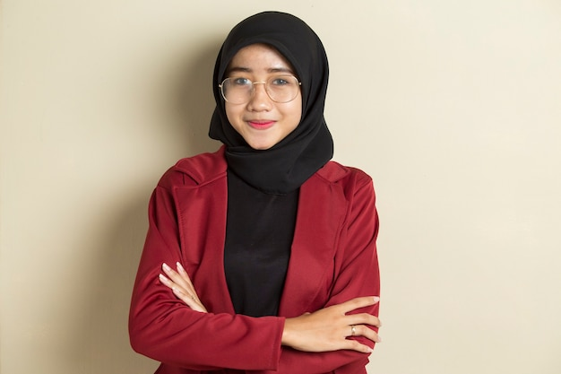 Portrait model of young beautiful muslim woman wearing hijab with glasses isolated