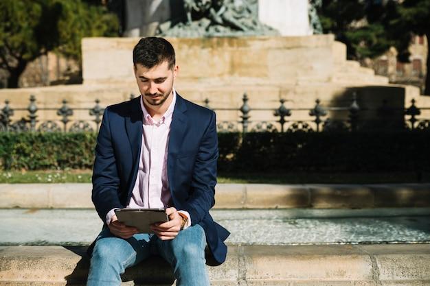 Portrait of modern businessman outdoors