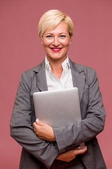Portrait of modern businesswoman standing