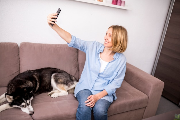 Portrait of modern woman at home with dog