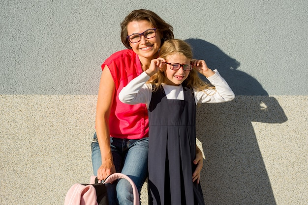 Portrait of a mom and daughter with glasses