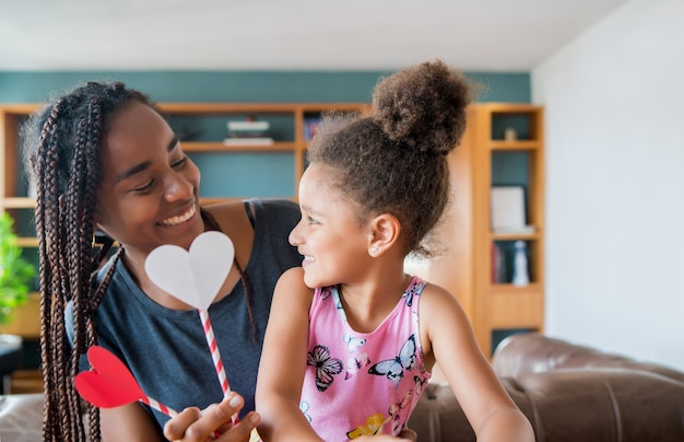 Portrait of a mother and her daughter smiling and spending time together while staying at home. monoparental concept. new normal lifestyle concept. Premium Photo
