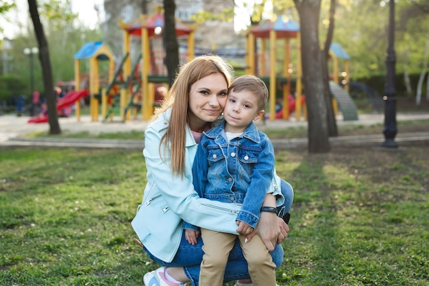 Portrait of mother and son in the park in the spring