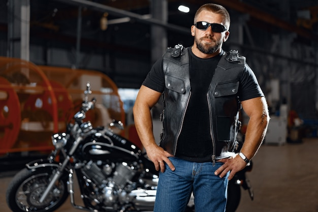 Portrait of motorbike rider in black leather outfit