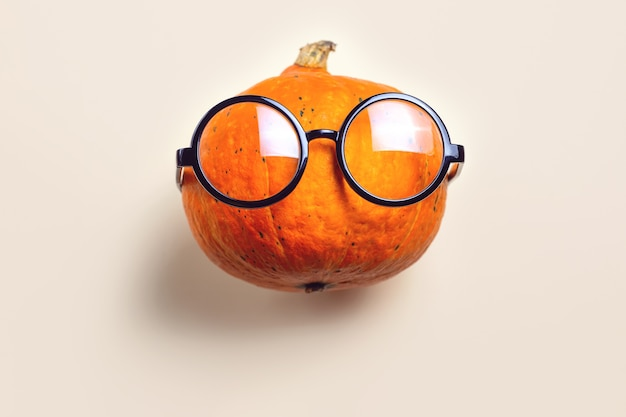 Portrait of mr. pumpkin with glasses. halloween concept.