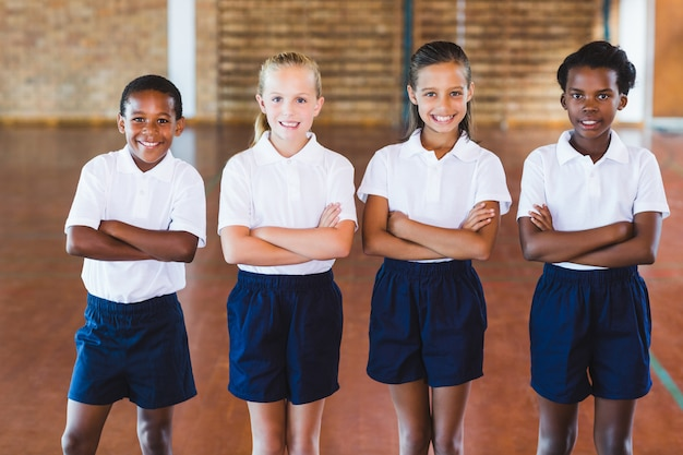 Portrait of multi-ethnic school kids standing with arms crossed