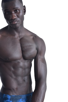 Portrait of a muscular african man on white