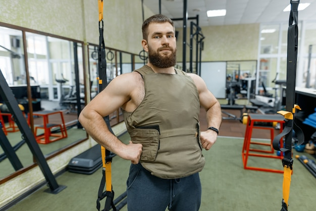 Portrait muscular caucasian bearded adult man in gym