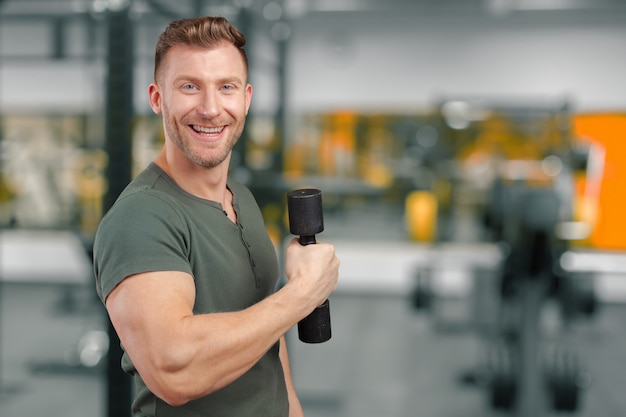 Portrait of a muscular man lifting weight