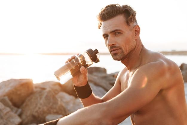 Portrait of a muscular shirtless sportsman