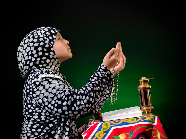 Portrait muslim girl praying