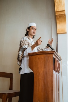 Portrait of muslim male preacher speech sharing about islam during prayer time in the mosque