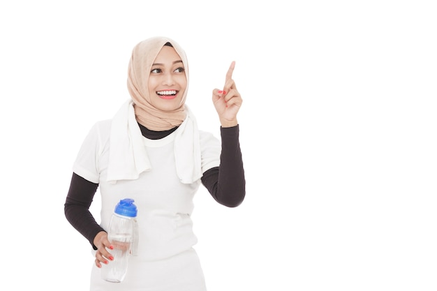 Portrait of muslim sporty woman holding a bottle of mineral water