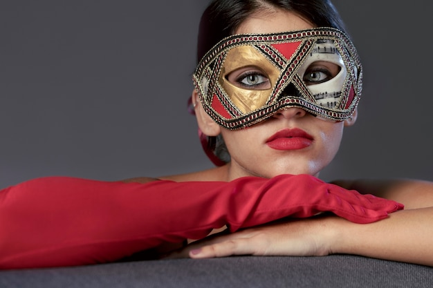 Portrait of mysterious woman with carnival mask