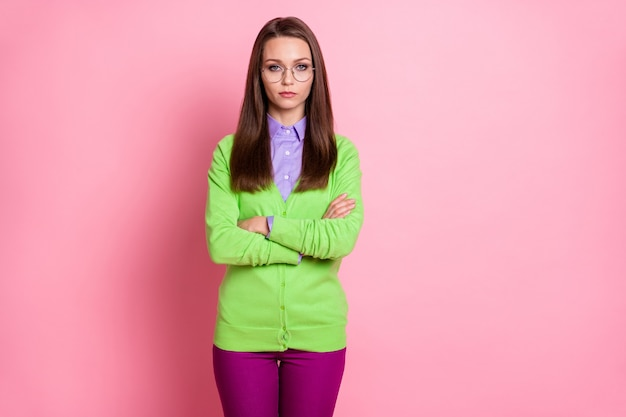 Portrait of nice attractive serious bored content girl geek folded arms isolated over pink pastel color background