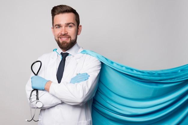 Portrait of nurse wearing hero cape