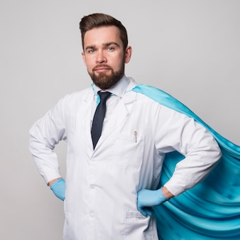 Portrait of nurse wearing hero cape