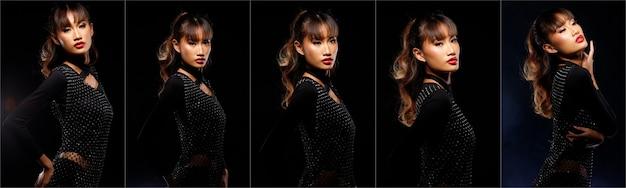 20代のアジア人女性の肖像日焼けした肌茶色のブロンドの髪のスタイル化粧品メイクアップ、黒いドレス赤い唇。孤立した暗い背景の上に女の子のポーズ