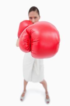 Portrait of a boxing businesswoman