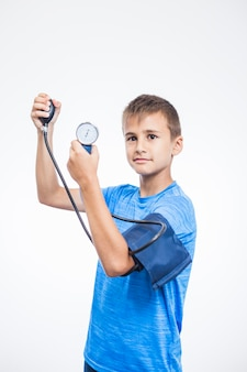 Portrait of a boy measuring blood pressure on white background