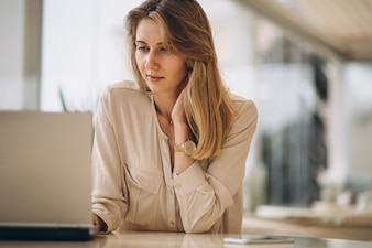 Portrait of a business woman working on laptop