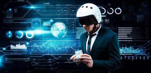 スーツと飛行士のヘルメットをかぶったビジネスマンの肖像画。彼は彼の前に百ドル札の束を持っています
