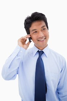 Portrait of a businessman making a phone call against a white background