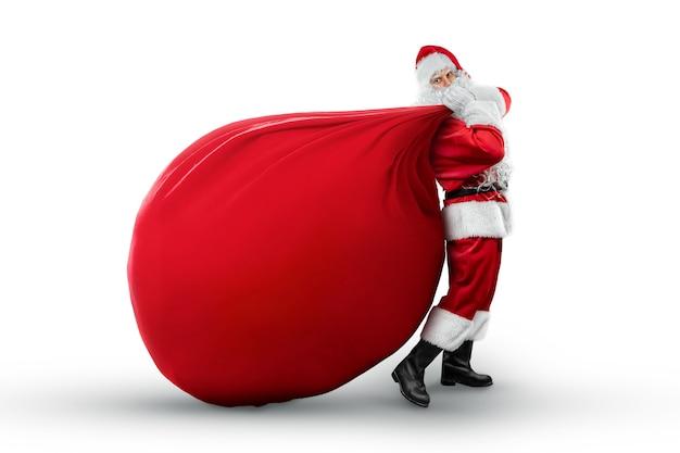 Портрет веселого деда мороза в красном костюме с большой сумкой
