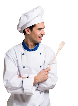 Portrait of a chef looking at his side. Isolated on white